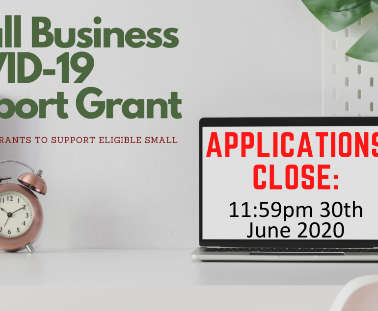 """Banner """"Small Business Covid-19 Support Grant"""". We have a clock on the bottom left of the image and a laptop on the bottom right."""