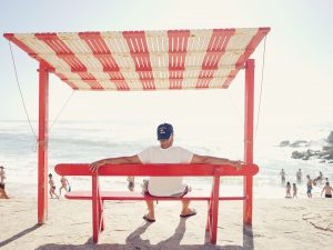A retired man on a bench at the beach superannuation fund related