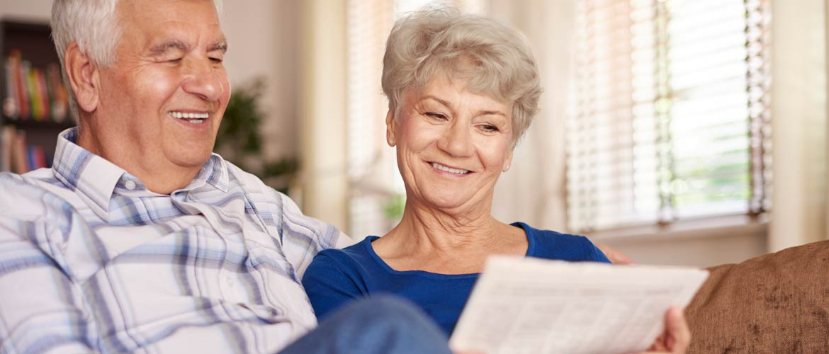 a photo for superannuation a retired couple holding superannuation fund papers
