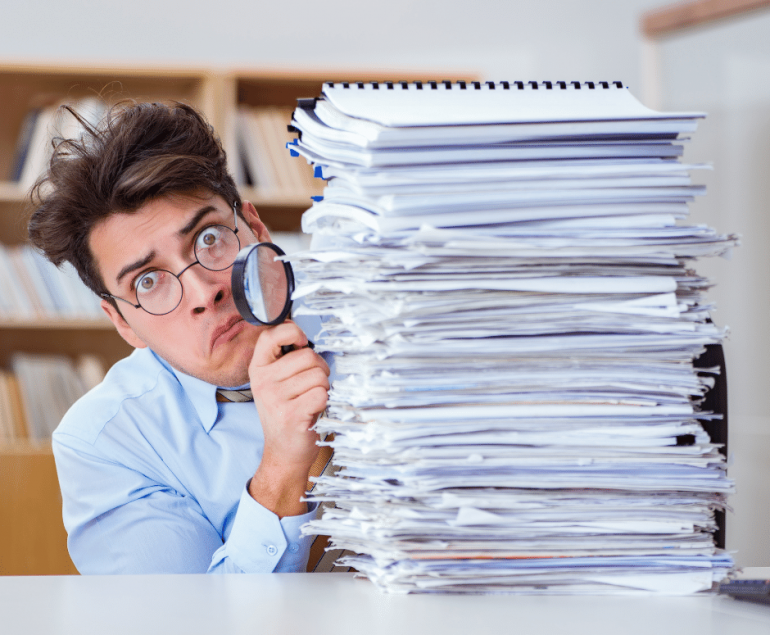 shocked man with stack of papers