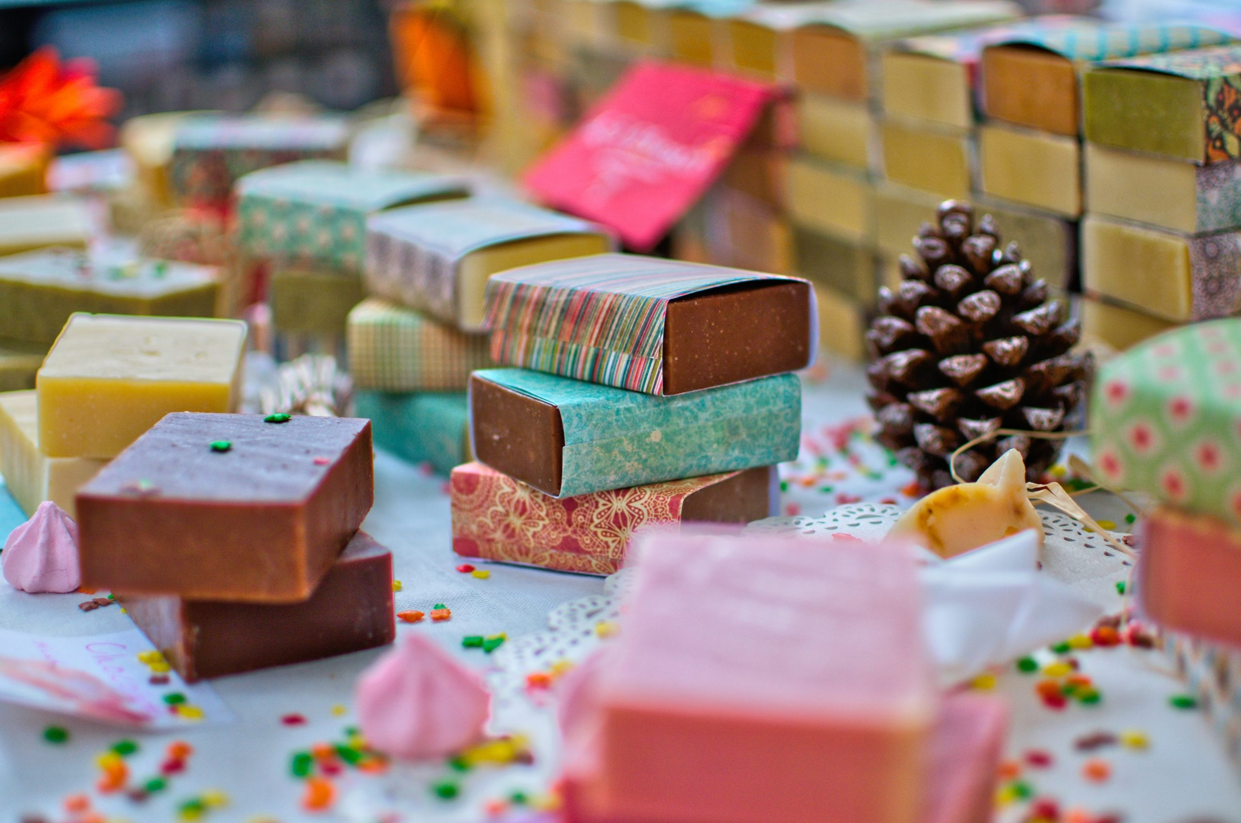 cakes of soap stacked o a table top. different colours. small business start ups