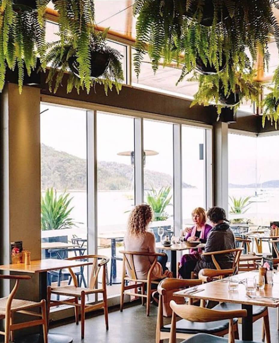 Three women taking coffee in a restaurant