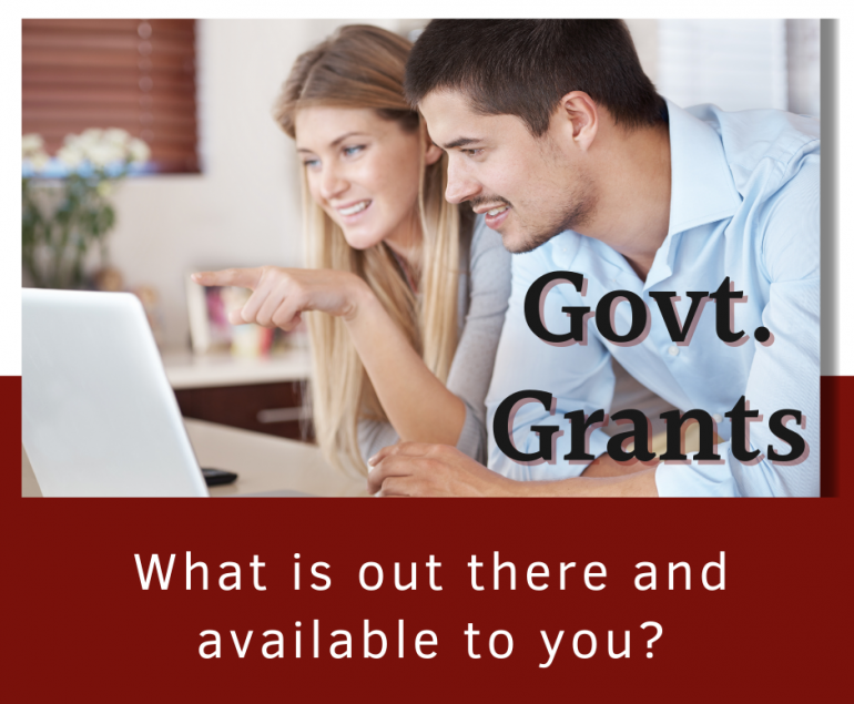 NSW Government Grants a man and a lady looking at a laptop screen