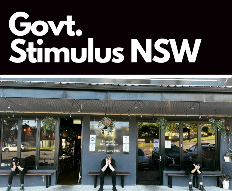 govt response to covid restrictions in nsw. 3 restaurant workers sitting out the front of their restaurant with their head in their hands in dissapointment